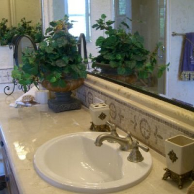 Large Vanity Mirror Accentuates Marble Counters